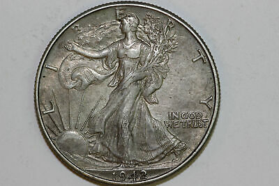 About Uncirculated 1942 P Liberty Walking 90% Silver Half Dollar (WL1411)