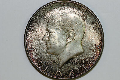 About Uncirculated 1964 P Toned Kennedy 90% Silver Half Dollar (KHX498)