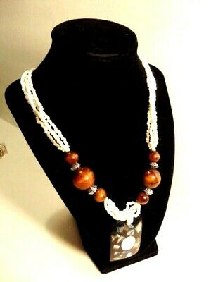 Modern mixed medium necklace: white glass beads; wood beads and a resin pendant