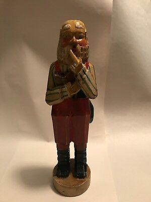 Hand Carved Wooden Santa For Christmas In A Thinking Pose