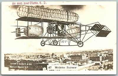 PLATTE S.D. 1910 AIRPLANE w/ EXAGGERATED CORN ANTIQUE REAL PHOTO POSTCARD RPPC