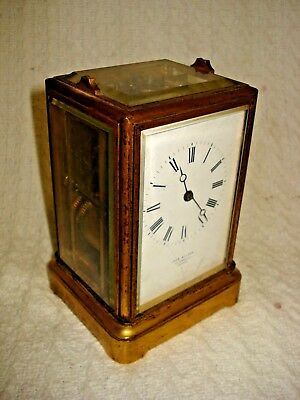 John Walker Carriage Clock brass/gold coloured with glass faces vintage/antique