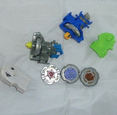 7 Beyblade lot metal pieces