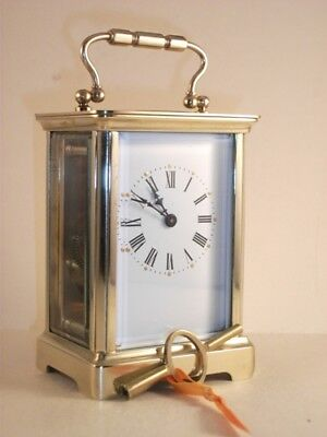Classic antique brass carriage clock & key. Restored and serviced December 2018