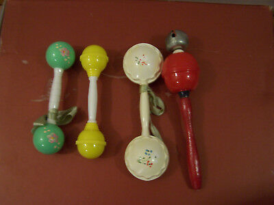 4 Vintage Baby Rattles - 1 w/wooden handle, the others all plastic