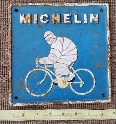 vtg MICHELIN Ad man bicycle CAST IRON sign plaque rusty rustic old garage 1946