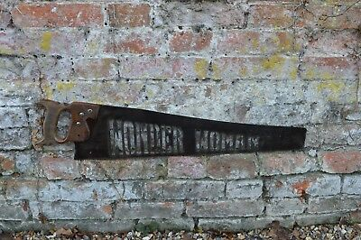 old antique vintage saw  metal plasma cutout wonder woman  , industrial sign