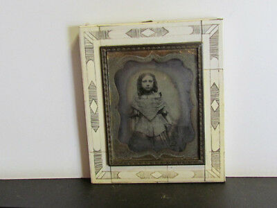 little girl ambrotype photograph in an unusual carved bone wall frame