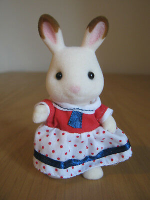 Sylvanian Families - Epoch UK Chocolate Rabbit Sister in Spotty Dress