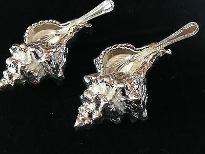 silver plated pair of heavy shell salts with spoons