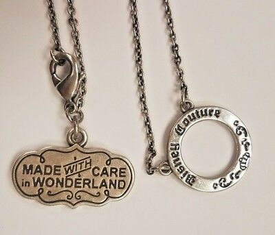 """DISNEY COUTURE Silver Tone Charm Necklace """"Made With Care In Wonderland"""""""