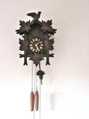 A Black Forest Hand Carved Cuckoo Clock