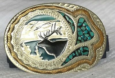 Vintage Wil-Aren elk belt buckle with turquoise- silver and gold tone.