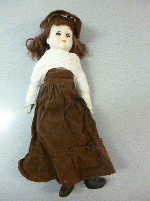 "porcelain doll 18"" tall open & close eyes with bonnet old but in good condition"