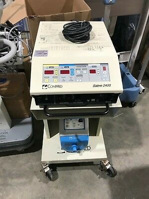 Conmed Sabre 2400 ESU w/ Bipolar Footswitch, Conmed Aer Defense, and Cart