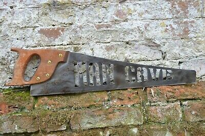 old antique vintage wood saw  metal plasma cutout  man cave , industrial sign