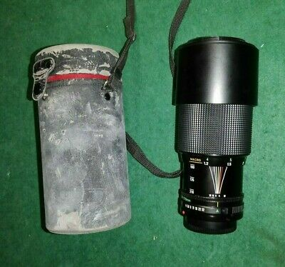 Canon Zoom Lens FD 70-210mm 1:4 with lens hood and leather case for SLR