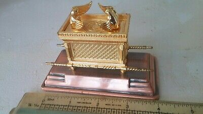 Raiders of The Lost Ark. Goldtone cast metal Ark of the Covenant on bronze base.