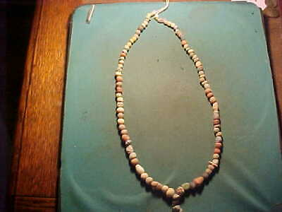 String of ancient Egyptian faience beads circa 1st millennium BC