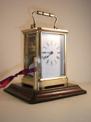 Antique French brass carriage clock & key. Recently restored and serviced.