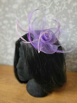 Purple clip and pin gauze and feather fascinator