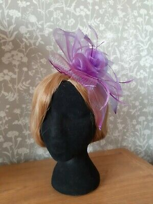 Purple net and feather fascinator with clip
