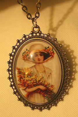 Lovely Lacy Rimmed Old Fashioned Lady with Hat Holding Bouquet Pendant Necklace