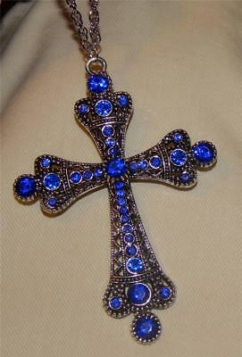 Gorgeous Large Blue Rhinestone Crowned Arm Silvertone Pectoral Cross Necklace