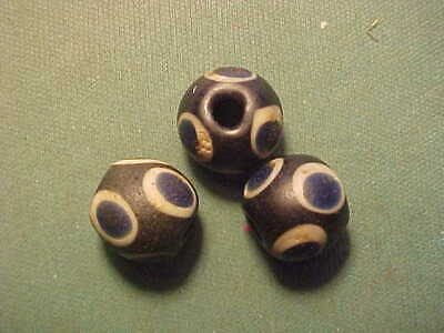 "Three (3) Islamic glass ""eye"" beads circa 12th century AD"