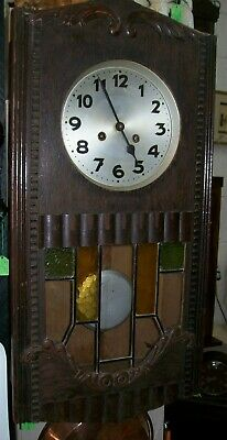 Antique Oak Striking Wall Clock Coloured Glass Panels