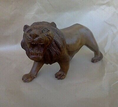 carved lion tree oak  handmade in a collection of wood