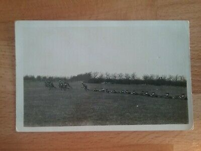 WW1 Postcard - Real Photographic shot of Soldiers in the Field of Battle