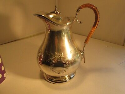 silverplated jug with lid and whicker covered handle