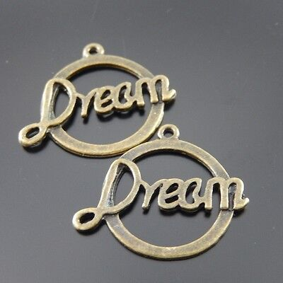 50pcs Antiqued Bronze Alloy Frame Dream Word Round Pendant Charms Crafts 38680
