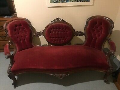 Antique settee/chaise longue. Victorian carved walnut & velvet upholstered.