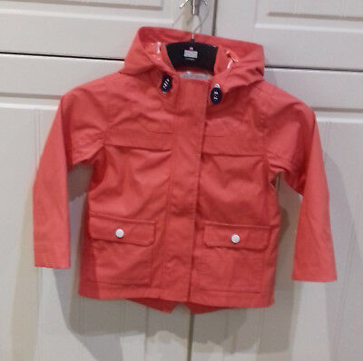 age 3-4 yrs fully lined orange jkt with white &orange lined hood & concealed zip