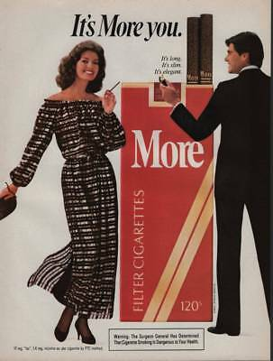 1983 More Cigarettes Vintage Magazine Ad Man with Lighter Pretty Lady Smoking