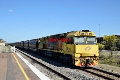 Photo  Nsw  Aurizon Class 5020 Co-Co No 5022 In Pineapple Livery On The Rear Of
