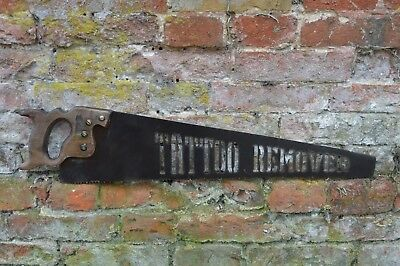 old antique vintage saw  metal plasma cutout tattoo remover, industrial sign