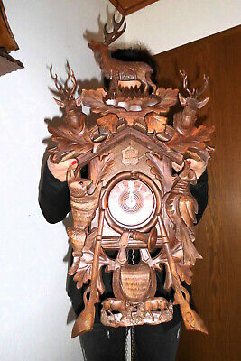 xl vintage cuckoo clock,orig germay regula 8 day clock hand carved . 75 cm top