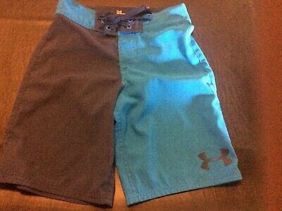 ad8e6d104582a Under Armour neon blues and navy blue boys swim suit trunks shorts size 26