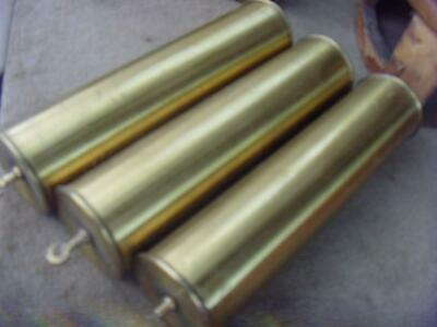 16468 Set of 3 old  brass filled clock long case weights approx  24.5cm x 6cm