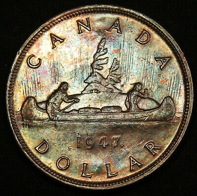 1947 ML Canada Silver Dollar Maple Leaf. Colorfully Toned. Rare Key Date coin.