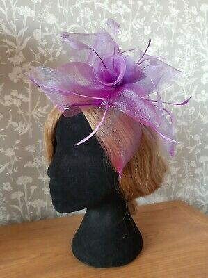 Purple net and feather fascinator with comb