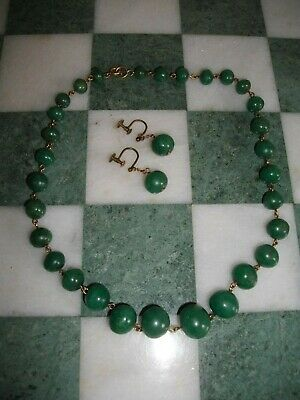 A vintage graduated jade bead necklace with matching earrings