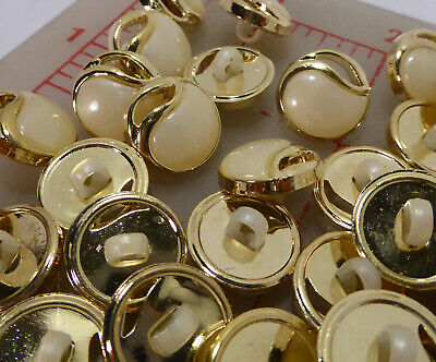 144 gold with ivory off white plastic shank buttons wavy cutout 15mm (sm)