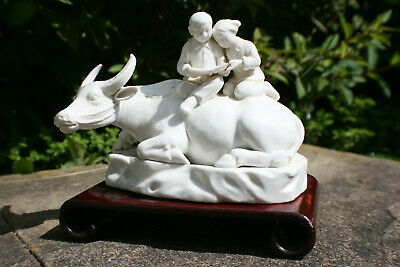 Chinese White Porcelain Carved Boy Girl Reading on Buffalo Figure w/ Wood Stand