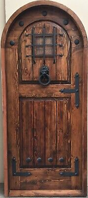 Rustic reclaimed lumber arched door solid wood story book castle winery