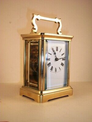 Classic antique brass carriage clock & key. Restored and serviced in Aug. 2019.