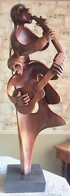 Large Wooden Hand Carved Sculpture of 2 musicians-made and bought in Ecuador